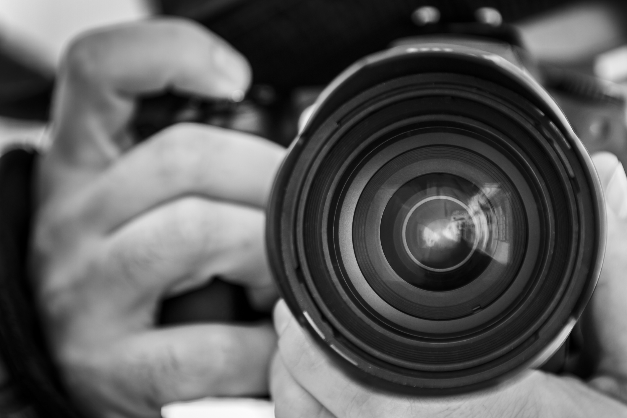 Close-up of hands holding a camera and taking pictures
