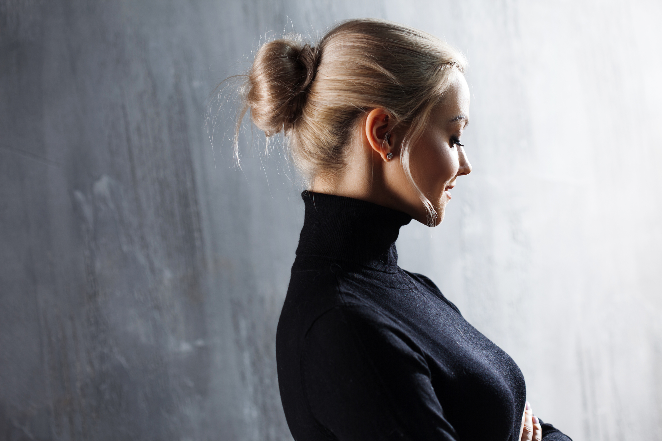 Portrait of beautiful blonde woman. Calm and self-confidence. Beautiful adult girl in black turtleneck