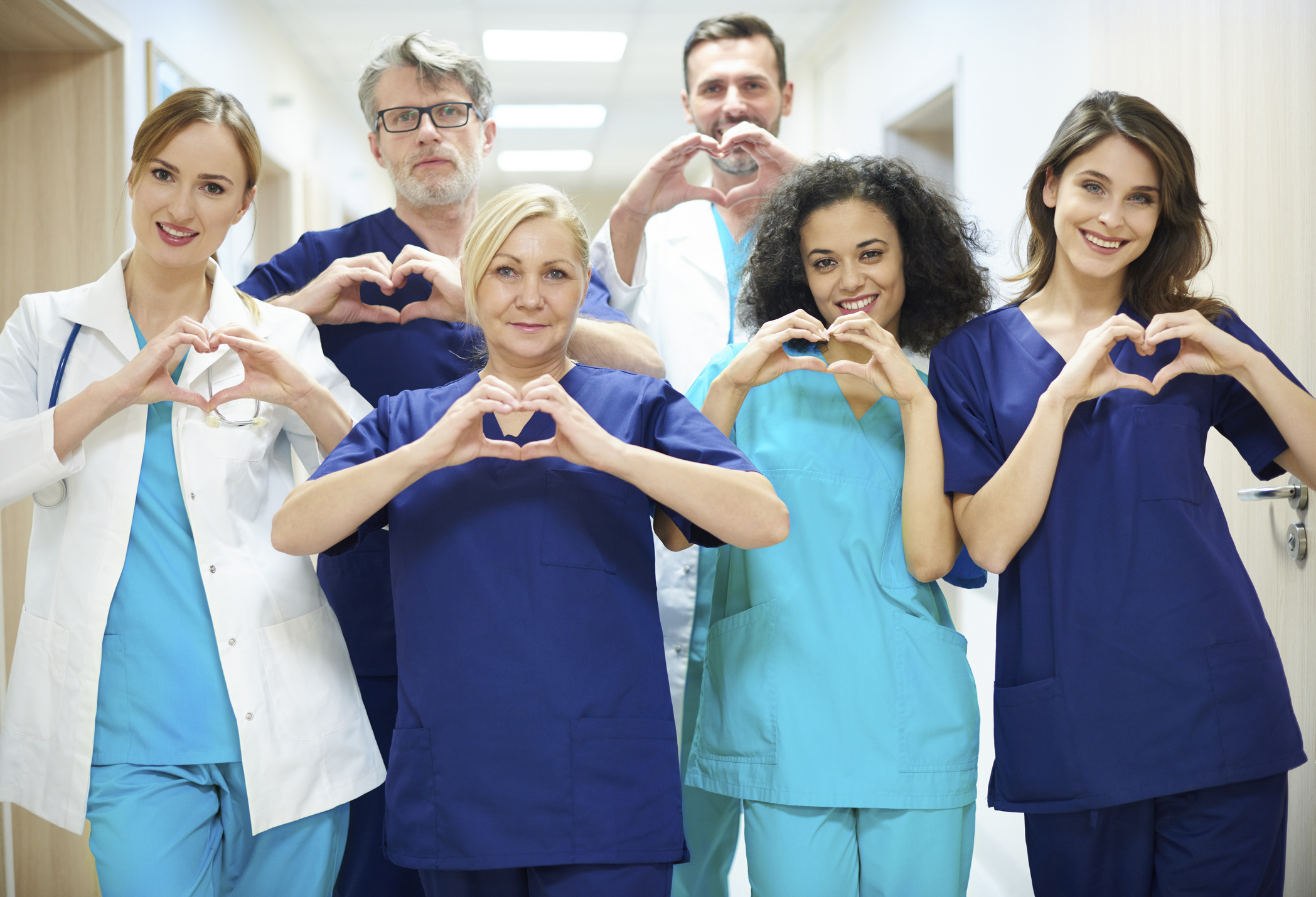 Group of doctors with heart symbol