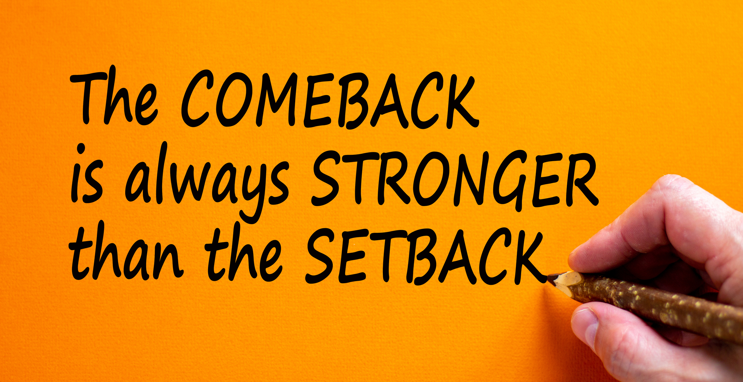 Comeback or setback symbol. Hand writing 'The comeback is always stronger than the setback', isolated on orange background. Business and comeback or setback concept, copy space.