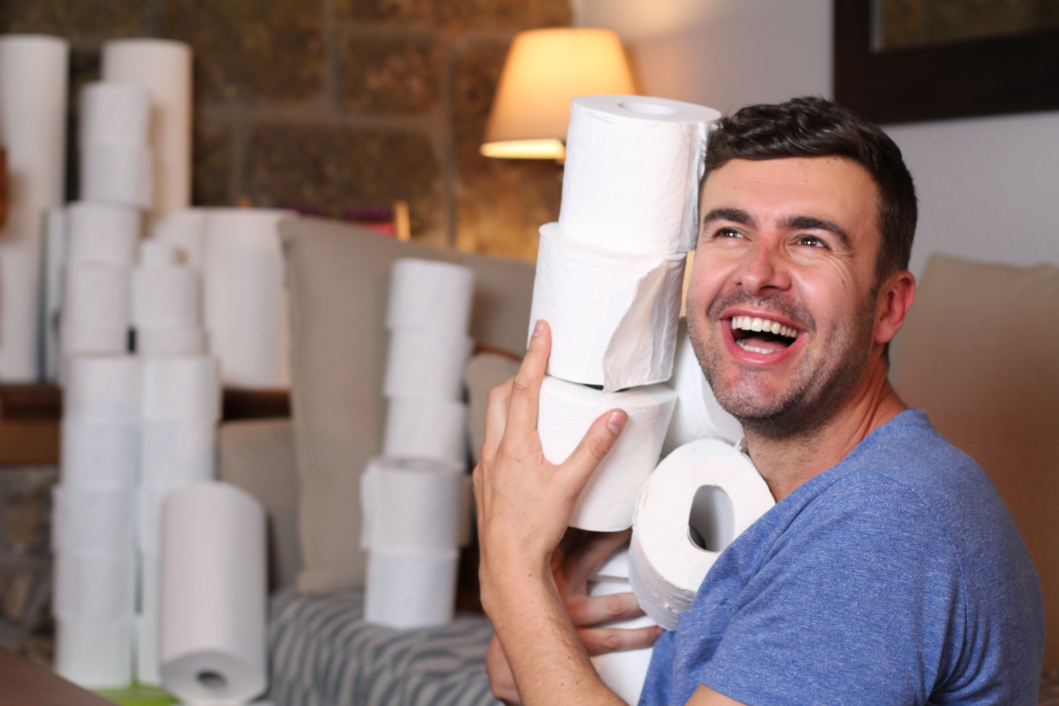 Man stocking up toilet paper at home